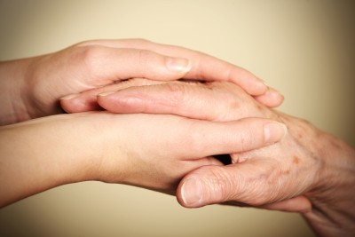 Old-and-young-hands-symbolizing-helping-the-elderly